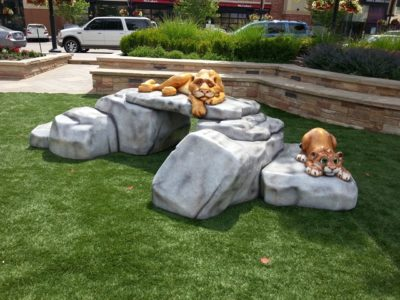 Lions on top of rocks play element created by Playtime