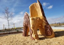 Outdoor Playtime park play area with side view of tree climbing structure