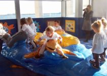 Kids playing on sea life play area