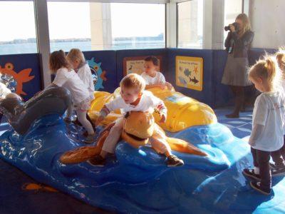 Kids playing on sea life play area