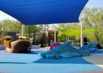 Hammer shark and pirate boat playtime elements in outdoor playground