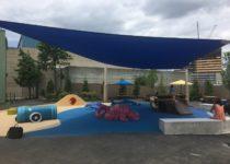 Covered outdoor play area at Adventure Aquarium