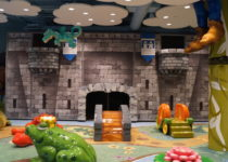 full view of fairytale themed playtime play area structures at lakeside shopping center