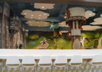 seating area and fairytale theme playtime play area at lakeside shopping center