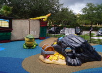 Outdoor Playtime play area with alligator, treasure chest and pirate ship play elements