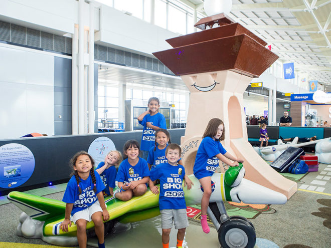 Kids playing in custom play area in airport