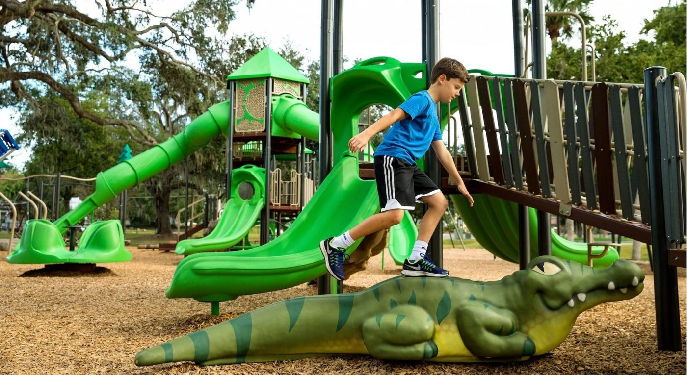 boy on crocodile on Playtime set outside