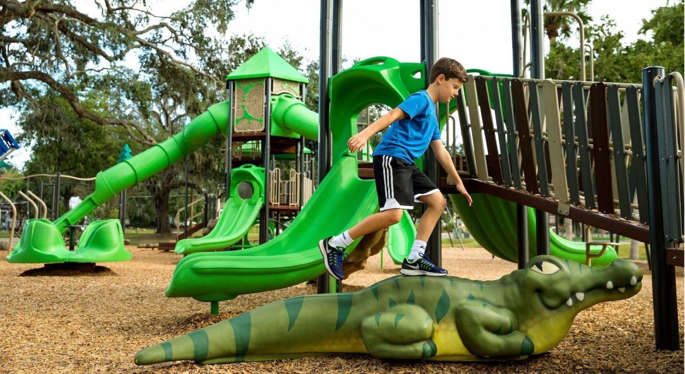 boy on crocodile on Playtime set outside