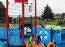 Outdoor Playtime play area with lighthouse playground and octopus slide