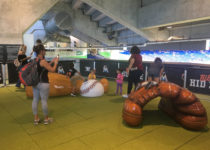 Kids playing on Playtime baseball themed structure at Miami Marlins Park