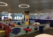 side view of airport theme play area with control tower and airplane by playtime at el paso airport