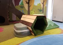 Indoor Playtime play area ramp with grassy tunnel