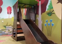 Indoor Playtime play area tree themed slide