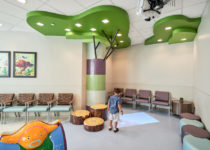 Waiting room of naples community hospital with child playing with playtime elements