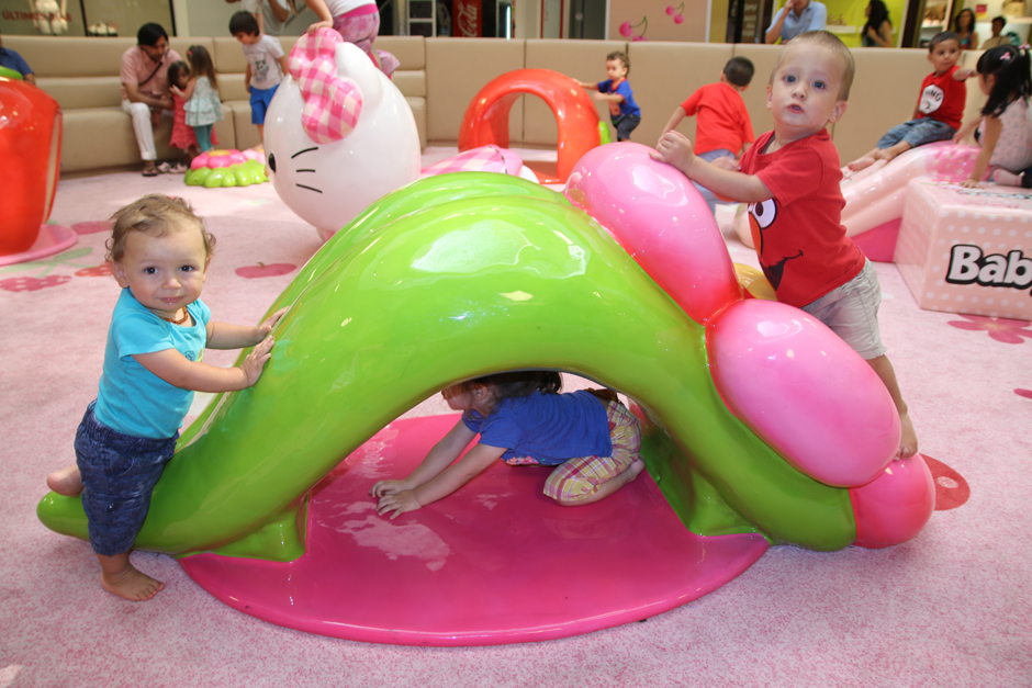 Toddlers playing on custom Hello Kitty element