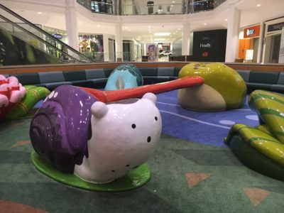 playtime climbing structures and seating area at twelve oaks mall