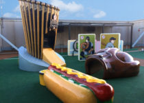 Playtime outdoor play area with baseball mit, hotdog and card play elements