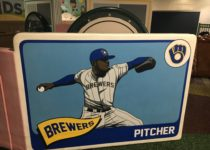oversized baseball card for milwaukee brewers baseball near playtime play area