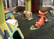 Indoor Playtime play area at shopping center with sheep, cow, and fox play elements
