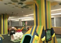 Indoor Playtime play area at shopping center with sheep and cow play elements