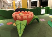 Indoor Playtime play area at shopping center with flower and bee play elements
