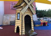 Custom windmill slide in play area
