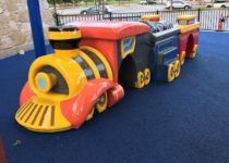 Train with tunnels in play area at Round Rock Premium Outlets
