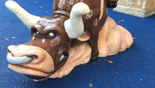 Bull sculpture in play area at Round Rock Premium Outlets