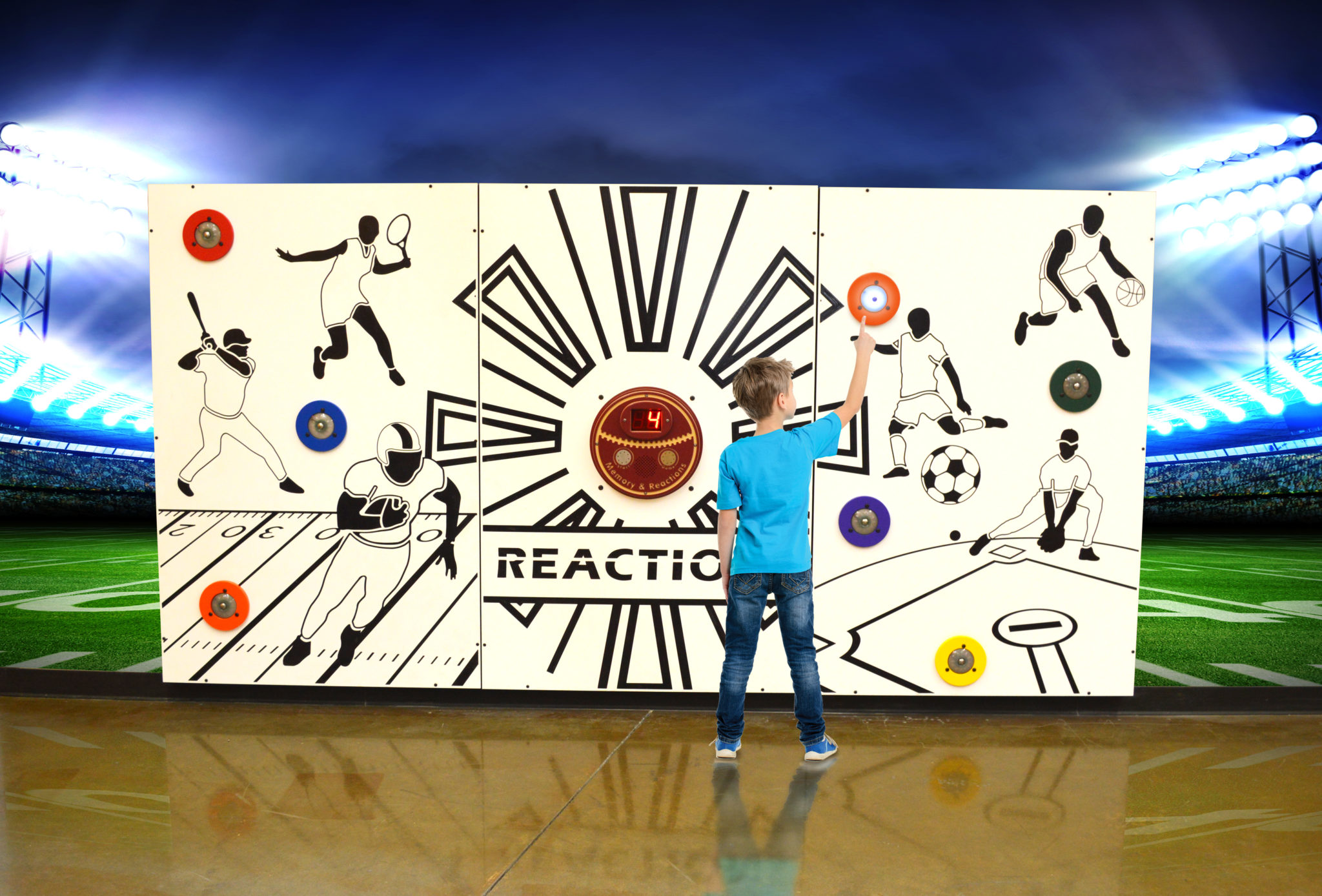 young boy playing with PLAYTIME interactive sports theme