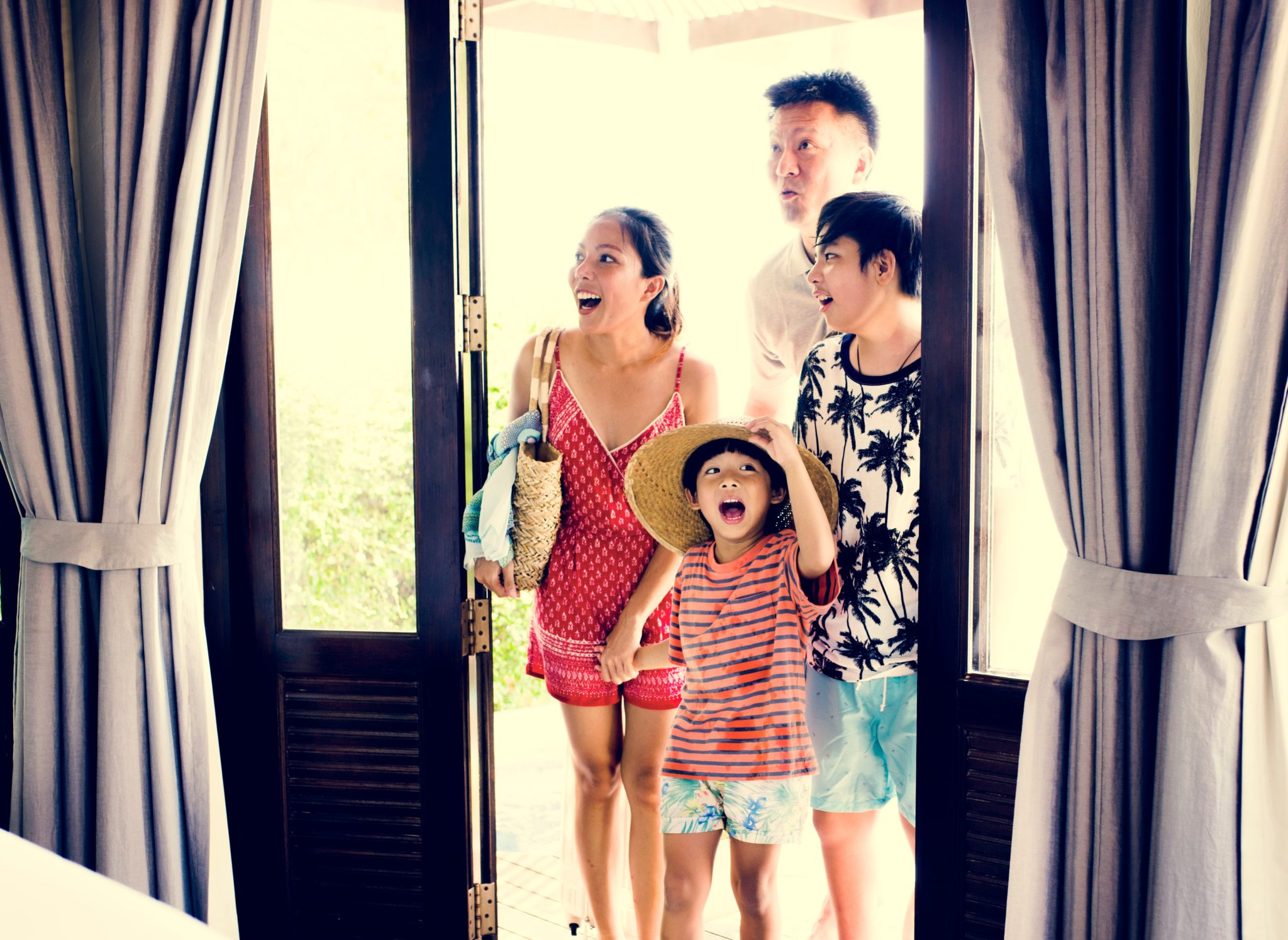 family excited to see their hotel room playtime