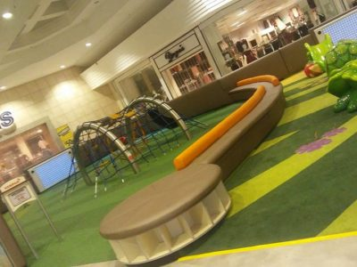 seating area at farm with vegetables theme indoor play area at Northridge Mall Play area by PLAYTIME