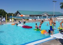 Kids having fun playing on playtime float features at pawnee plunge