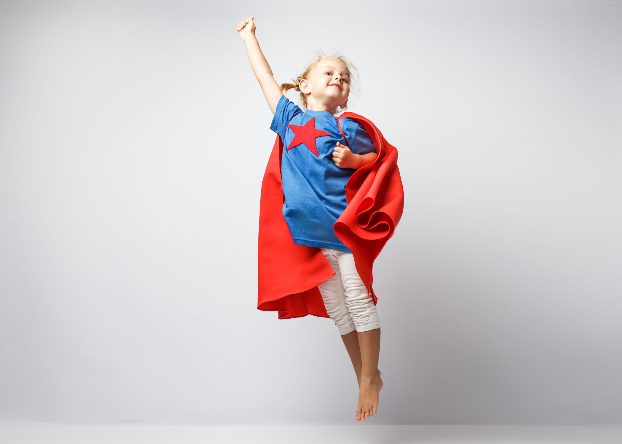 young girl dressed as superhero PLAYTIME