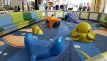 Under the sea themed play area with bench seating surrounding